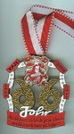"""Der Orden im Jubiläumsjahr: Hauptsymbol                  ist eine 66, wobei eine 6 spiegelverkehrt steht, so dass die beiden Sechsen """"Stippeföttche"""" tanzen."""